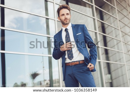 Handsome male model posing wearing a blue suit. #1036358149