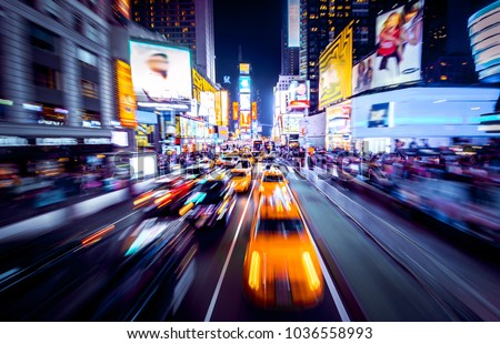 Time Square - New York in movement. Shot of cars in movement with motion blur. #1036558993