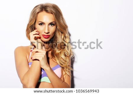 Fashion photo of beautiful and young lady in swimsuits posing in #1036569943
