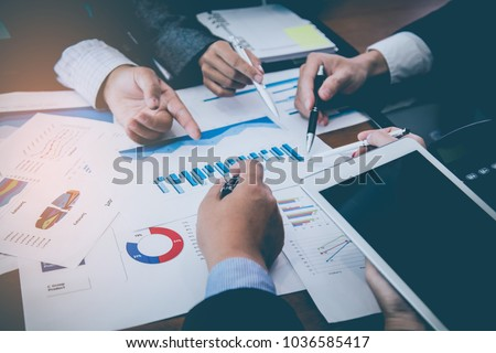 Corporate meetings, Business team organizations and investment plans at working with new startup project with chart,graph and business accessories on workplace. #1036585417