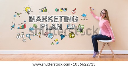 Marketing Plan with young woman holding a pen in a chair #1036622713
