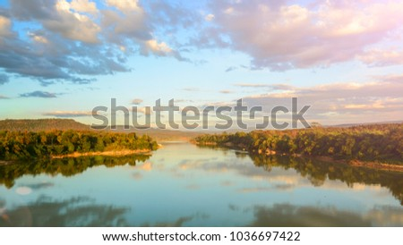 Evening landscape of river with forest and reflection clound. #1036697422