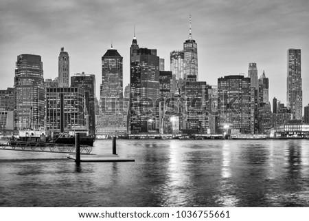 Black and white New York City skyline at night, USA.