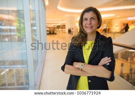 Portrait of mature businesswoman exploring the city of Bangkok, Thailand #1036771924