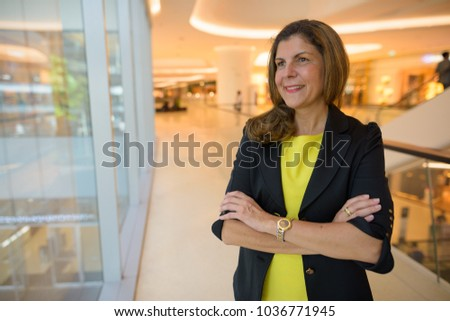 Portrait of mature businesswoman exploring the city of Bangkok, Thailand #1036771945