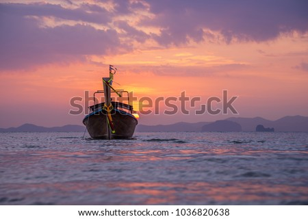 Traditional long-tail boat on the beach in Thailand #1036820638