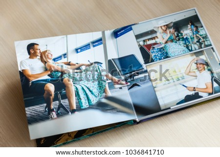 Album with photos of travel and vintage Royalty-Free Stock Photo #1036841710