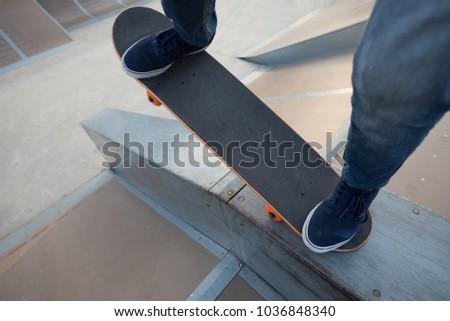 skateboarder legs skateboarding on skatepark #1036848340