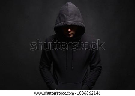 Man in Hood. Dark figure in a hooded sweatshirt. Incognito Boy #1036862146