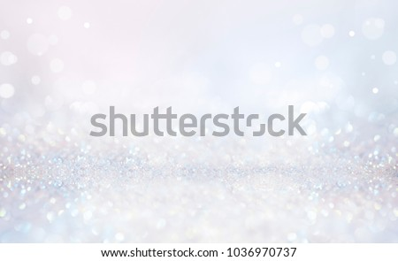Glitter christmas background in pastel delicate silver and white tones de-focused. #1036970737