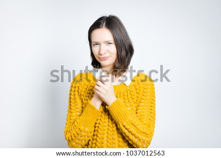beautiful young woman has pain in hand, isolated on gray background #1037012563
