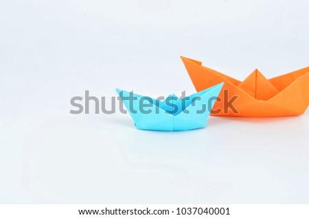 origami boats orange and blue on white background. #1037040001