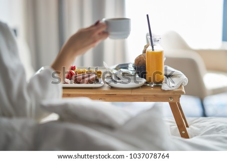 Breakfast in bed, cozy hotel room. concept Royalty-Free Stock Photo #1037078764