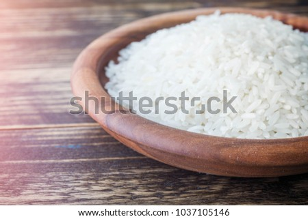 Rice in a plate on a wooden table, copy space #1037105146
