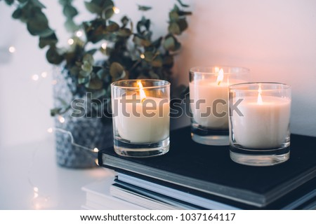 Cozy home interior decor, burning candles Royalty-Free Stock Photo #1037164117