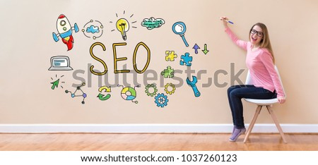 SEO with young woman holding a pen in a chair #1037260123