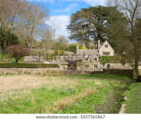 """Ancient village """"Lower Slaughter"""" in the Cotswolds region #1037365867"""