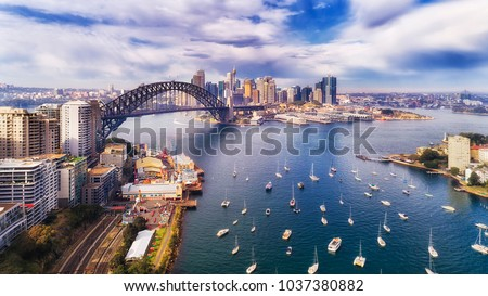 Lavender bay of Sydney harbour near Sydney harbour bridge off Lower North Shore in view of The Rocks, Barangaroo and city CBD. #1037380882
