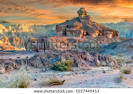 Unique geological formations belonging to Jurassic period in nature Timna park, Israel Royalty-Free Stock Photo #1037449453