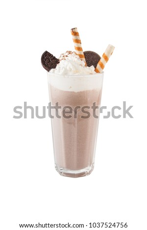 Chocolate milkshake with chunks of chocolate and cookies on top, isolated on white. #1037524756