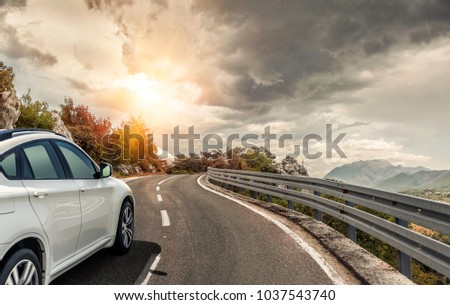 White car rushing along a high-speed highway. Toned photo. #1037543740