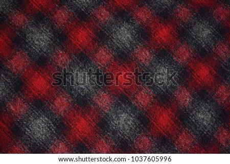 Closeup of woolly plaid fabric in red and grey #1037605996