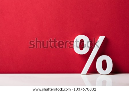 Close-up Of A Percentage Sign Leaning On Red Wall #1037670802