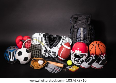 Close-up Of Various Sport Equipments Isolated On Black Background #1037672710