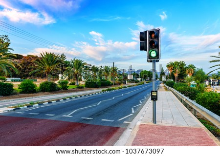 green light on traffic light and road