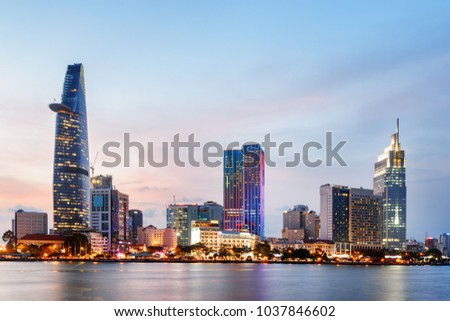 Ho Chi Minh City skyline and the Saigon River at sunset. Amazing colorful view of skyscraper and other modern buildings at downtown. Ho Chi Minh City is a popular tourist destination of Vietnam. #1037846602