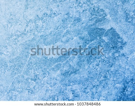 Aerial view of frozen lake. Ice from drone view. Dam Ceske Udoli near Pilsen, Czech republic, European union. Background texture concept. Royalty-Free Stock Photo #1037848486