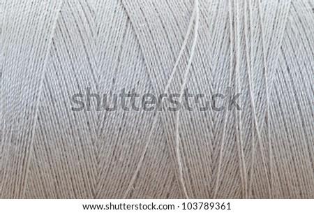 closeup of beige thread #103789361