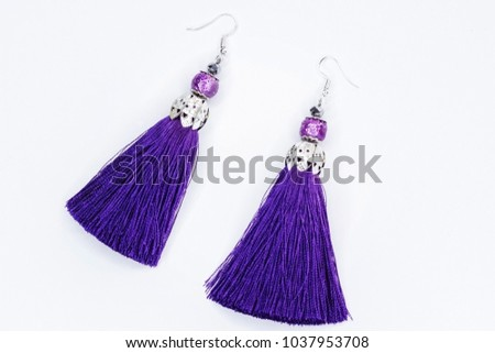Sergi-tassels made of silk thread and jewelry on a white background. Handmade. #1037953708