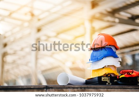 Teamwork of the construction team must have quality. Whether it is engineering, construction workers. And have a helmet to wear at work. For safety at work. copy space #1037975932