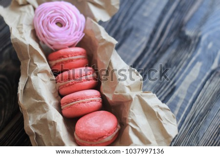 Colorful macaroons and flowers on table #1037997136