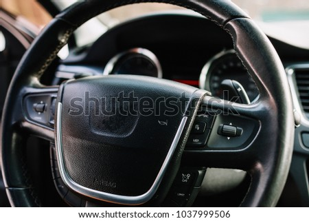 Modern car interior (shallow DOF - selective focus; color toned image) #1037999506