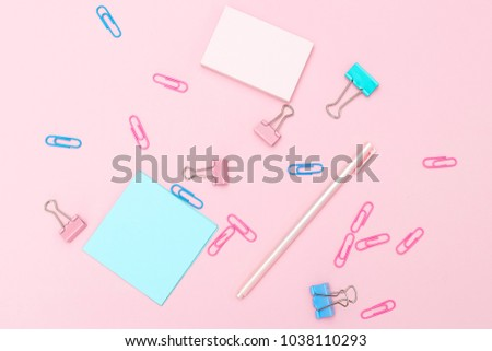 Desk and stationery pastel colored. Flat lay
