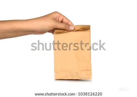 Holding brown paper bags on white background. #1038126220