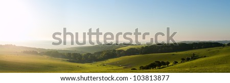 Beautiful sunrise over English countryside landscape in Summer #103813877