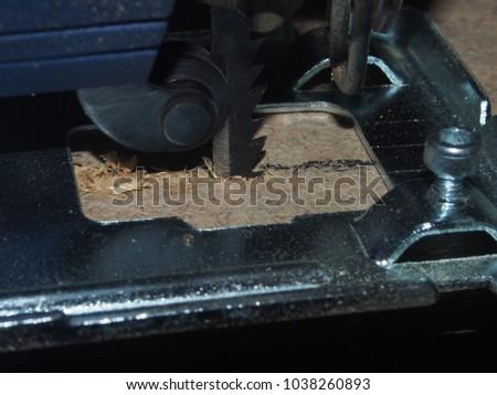 Chipboard sawn PR using an electric jigsaw. Close up. #1038260893