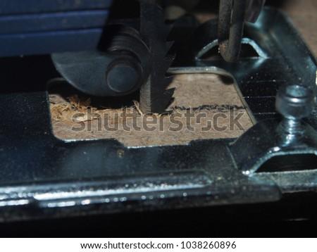 Chipboard sawn PR using an electric jigsaw. Close up. #1038260896