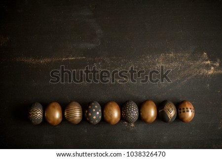 Background with golden decorated easter eggs #1038326470