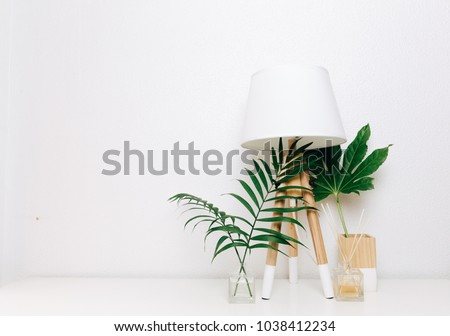 Hipster Scandinavian style room interior. Nordic lamp with tropical leaves. Minimalist style