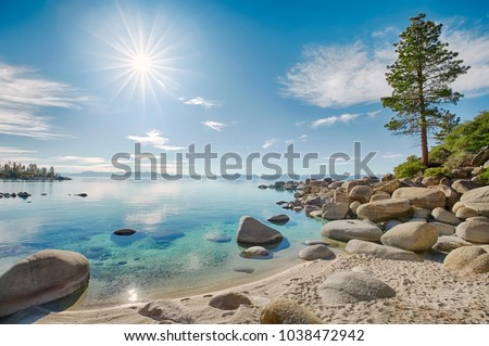 Lake Tahoe east shore beach, calm turquoise water in sunny day  Royalty-Free Stock Photo #1038472942