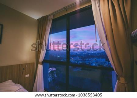 Beautiful sunset vies from bedroom window. #1038553405