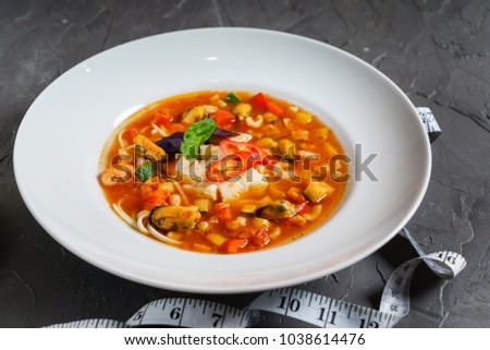 seafood soup with vegetables #1038614476