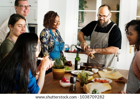 Diverse people joining cooking class #1038709282