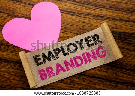 Writing text showing Employer Branding. Business concept for Brand Building written on sticky note paper, wooden background. With pink heart meaning love adoration. #1038725383