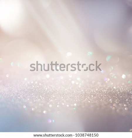 Glitter background in pastel delicate beige and pearl tones, de-focused, free space #1038748150