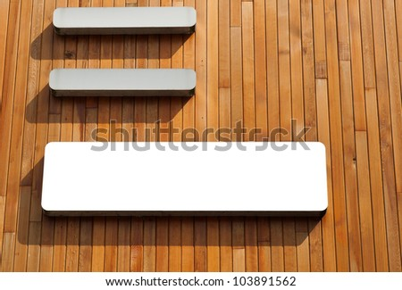 exterior billboard on a wooden background (isolated on white) for your design